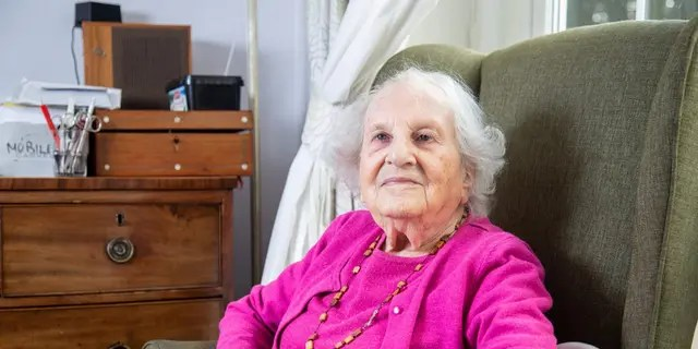Alice Frank Stock at her retirement home in Bristol, England.  Alice said she sometimes saw Hitler being rushed into the building while flanked by towering SS guards - likely fearing an assassination attempt.  (Credit: SWNS)
