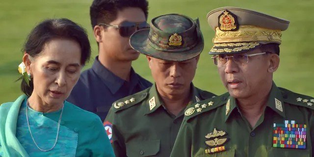 On this 6 May 2016, file photo, Aung San Suu Kyi, left, Burma's Foreign Minister, Senior General Min Aung Hlaing, right, Commander-in-Chief of the Burma Army, moves to Nyepitawa, Burma.  (AP Photo / Ang Shine Oo, File)