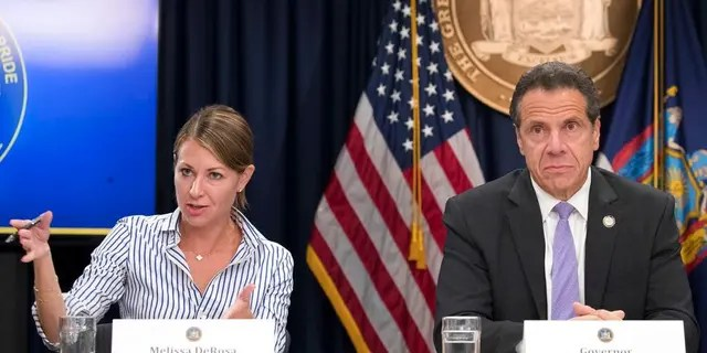 "In this Sept. 14, 2018 file photo, Secretary to the Governor Melissa DeRosa, is joined by New York Gov. Andrew Cuomo as she speaks to reporters during a news conference, in New York. De Rosa, Cuomo's top aide, told top Democrats frustrated with the administration's long-delayed release of data about nursing home deaths that the administration ""froze"" over worries about what information was ""going to be used against us,"" according to a Democratic lawmaker who attended the Wednesday, Feb. 10, 2021 meeting and a partial transcript provided by the governor's office. (AP Photo/Mary Altaffer, File)"