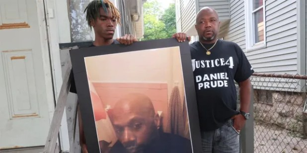 FILE - In this Sept. 3, 2020 file photo, Joe Prude, brother of Daniel Prude, right, and his son Armin, stand with a photo of Daniel Prude in Rochester, NY (AP Photo / Ted Shaffre, Archive)