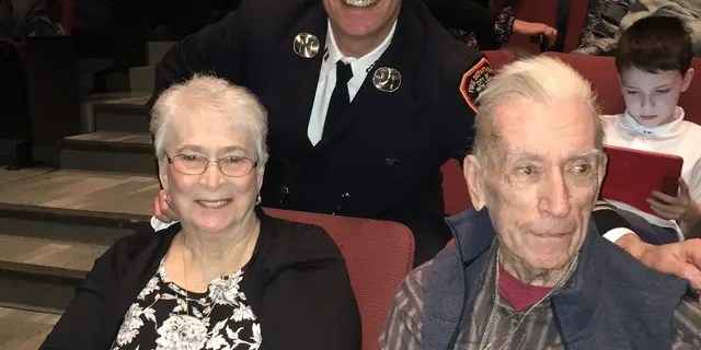 Janice Dean's in-laws Dee and Mickey Newman attend their son Sean's promotion ceremony to battalion chief