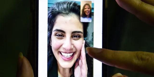 This photo, taken in Saudi Arabia's capital Riyadh on February 10, 2021, shows a woman looking at Leena's tweet by the sister of Saudi activist Loujain al-Hathlaul, of whom Hathloo after being detained for nearly three years. A screenshot of her was shown after the release of.  (Photo by Fez Neureldin / AFP) (Photo via Geta Image by Feetz Neureldin / AFP)