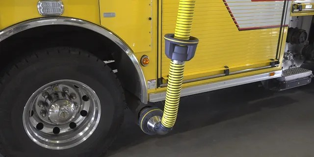 The Goodyear Fire Department has a bright yellow hose hooked up to the exhaust of their fire trucks, which will then redirect harmful fumes into and out of the station.