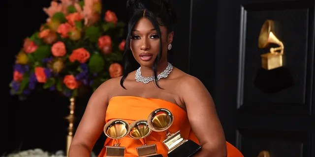 """Megan Thee Stallion, winner of the awards for best rap song and best rap performance for """"Savage Remix"""" and best new artist poses in the press room at the 63rd annual Grammy Awards at the Los Angeles Convention Center on Sunday, March 14, 2021. (Photo by Jordan Strauss/Invision/AP)"""