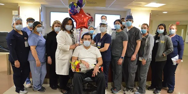 Alfredo Hercules is pictured with various staff who helped care for him during his months-long stay.