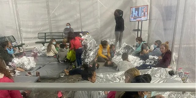 Images of migrants taken Friday, March 26, 2021, at the Donna U.S. Customs and Border Protection (CBP) facility in Texas. Sen. Mike Braun, R-Ind., took the pictures while touring the facility with other GOP senators.