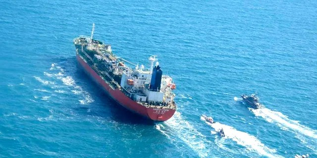 A photo obtained by AFP from the Iranian news agency Tasnim on Jan. 4, 2021, shows the South Korean-flagged tanker being escorted by Iran's Revolutionary Guards navy after being seized in the Gulf. (Getty Images)