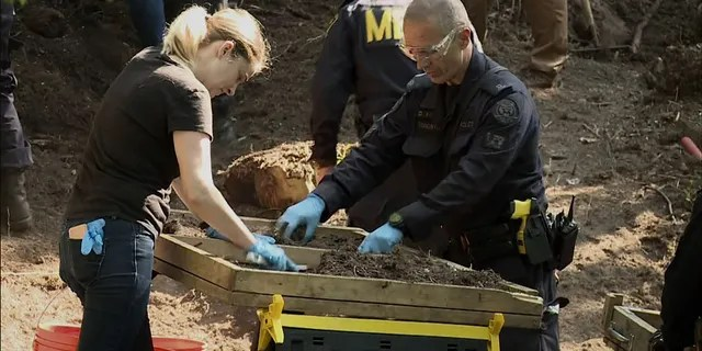 Investigators sift through compost for human remains in the back area of 53 Mallory Crescent in Toronto, July 5, 2018. The property is linked to the Bruce McArthur murder investigation.