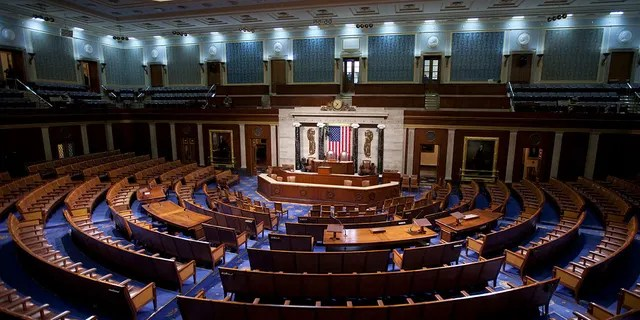 An empty House of Representatives Chamber on Capitol Hill in Washington. (Photo by Brooks Kraft LLC/Corbis via Getty Images)