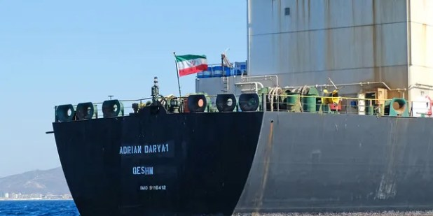 FILE - An Iranian flag flies aboard the Adrian Darya tanker, formerly known as Grace 1, off the coast of Gibraltar on August 18, 2019 (Photo by JOHNNY BUGEJA / AFP via Getty Images).