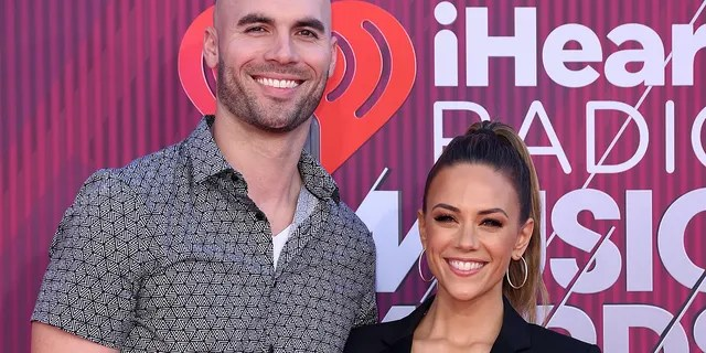 Kramer filed for divorce from NFL player Mike Caussin, left. (Photo by Presley Ann/WireImage)