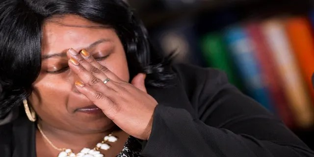 Samaria Rice, the mother of Tamir Rice, touches her hand to her face during an interview with the Associated Press in New York in 2014. (AP)