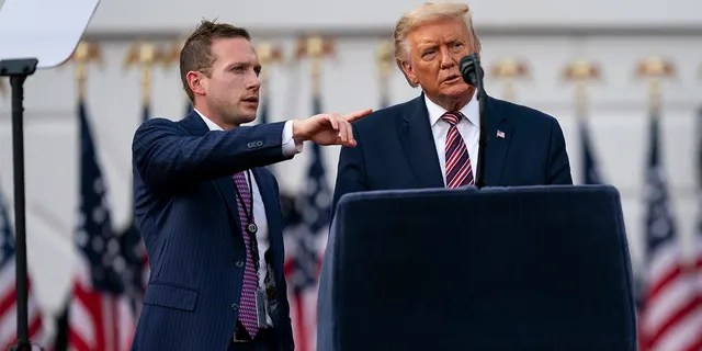 Former President Donald Trump talks with former Deputy Campaign Manager for Presidential Operations Max Miller, left before his speech to the Republican National Convention on the South Lawn of the White House, Thursday, Aug. 27, 2020, in Washington. Miller is now running for Congress against Rep. Anthony Gonzalez, R-Ohio, who voted to impeach Trump. (AP Photo/Evan Vucci)