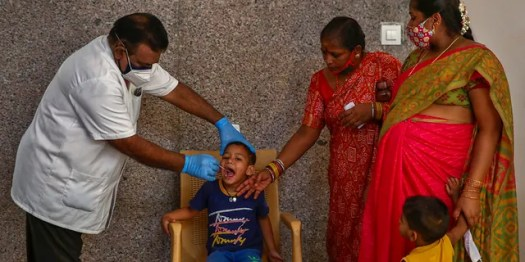 April 29, 2021: A health worker takes a mouth swab sample of a boy to test for COVID-19 in Hyderabad, India.