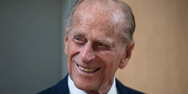 FILE - In this June 8, 2015 file photo Britain's Prince Philip, husband of Queen Elizabeth II, smiles after unveiling a plaque at the end of his visit to Richmond Adult Community College in Richmond, south west London.  Buckingham Palace said Friday that Prince Philip, the irritable and tough-minded husband of Queen Elizabeth II, who spent more than seven decades supporting his wife in a role that defines and narrows her life, has died. Has occurred.  That's 99.  belonged to