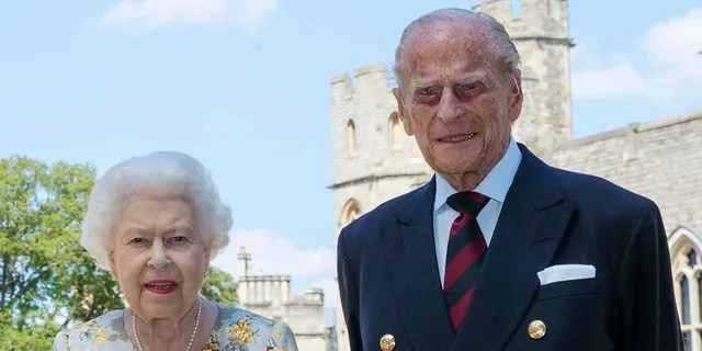 In this June 1, 2020 file photo, British Queen Elizabeth II and Prince Philip pose for a photo in the Quadrangle of Windsor Castle in Windsor, England, ahead of her 99th birthday on Wednesday June 10.