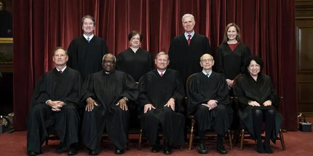 FILE - In this April 23, 2021, file photo members of the Supreme Court pose for a group photo at the Supreme Court in Washington. Seated from left are Associate Justice Samuel Alito, Associate Justice Clarence Thomas, Chief Justice John Roberts, Associate Justice Stephen Breyer and Associate Justice Sonia Sotomayor, Standing from left are Associate Justice Brett Kavanaugh, Associate Justice Elena Kagan, Associate Justice Neil Gorsuch and Associate Justice Amy Coney Barrett. Barrett and Thomas came down on opposite sides of a case for the first time since she joined the bench Thursday. (Erin Schaff/The New York Times via AP, Pool, File