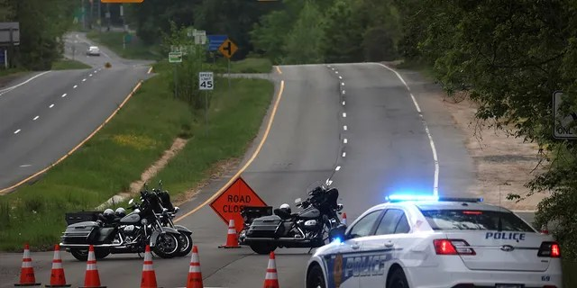 Dolley Madison Boulevard is blocked off by law enforcement in response to a security-related situation outside of the secure perimeter near the main gate of CIA headquarters in Virginia, U.S. May 3, 2021. REUTERS/Leah Millis