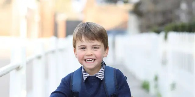 In this handout photo provided by the Duchess of Cambridge, Britain's Prince Louis smiles before his first day of attending Willcocks Nursery School, at Kensington Palace in London, Wednesday, April 21, 2021. Prince Louis turns three years old on Friday April 23. (Duchess of Cambridge via AP)