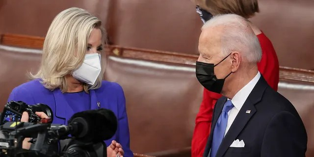 House Republican Conference Chairperson Rep. Liz Cheney, R-Wyo., speaks with President Joe Biden as he arrives to address a joint session of Congress, Wednesday, April 28, 2021, in the House Chamber at the U.S. Capitol in Washington. (Jonathan Ernst/Pool via AP)