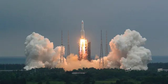 In this photo released by China's Xinhua News Agency, a Long March 5B rocket carrying a module for a Chinese space station lifts off from the Wenchang Spacecraft Launch Site in Wenchang in southern China's Hainan Province, Thursday, April 29, 2021. (Ju Zhenhua/Xinhua via AP)