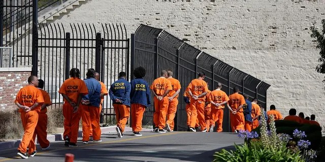 In this August 2016 photo, a row of general population inmates walk in a line at San Quentin State Prison in San Quentin, California.