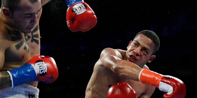 Puerto Rico's Felix Verdejo, right, punches Costa Rica's Bryan Vazquez during the fifth round of a lightweight boxing match in New York on April 20, 2019. (AP Photo/Frank Franklin II, File)