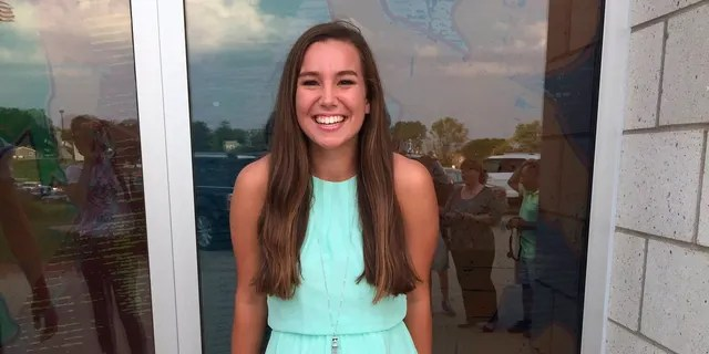 In this September 2016 file photo provided by Kim Calderwood, Mollie Tibbetts poses for a picture during homecoming festivities at BGM High School in her hometown of Brooklyn, Iowa. (Kim Calderwood via AP, File)