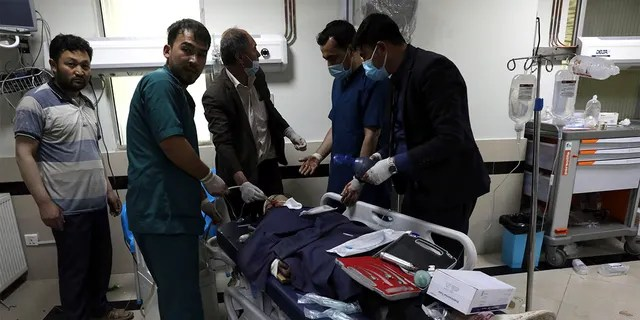 An Afghan school student is treated at a hospital after a bomb explosion near a school west of Kabul, Afghanistan, Saturday, May 8, 2021. A bomb exploded near a school in west Kabul on Saturday, killing several people, many them young students, an Afghan government spokesmen said. (AP Photo/Rahmat Gul)