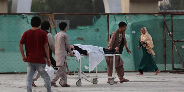 An injured school student is transported to a hospital after a bomb explosion near a school in west of Kabul, Afghanistan, Saturday, May 8, 2021. (Associated Press)