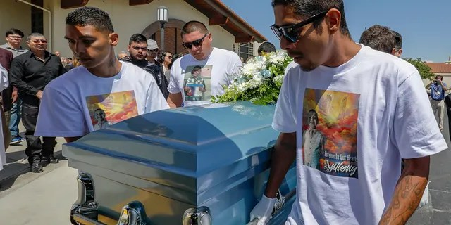 Victor Avalos, right, father of Anthony Avalos, and other family members bring out the casket after funeral services held at Saint Junipero Serra Parish on July 20, 2018 in Quartz Hills, California. (Getty Images)
