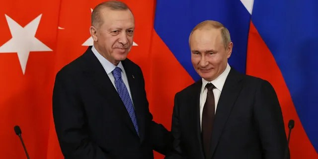 Russian President Vladimir Putin and Turkish President Recep Tayyip Erdogan shake hands during their talks at the Kremlin on March 5, 2020, in Moscow, Russia. (Photo by Mikhail Svetlov/Getty Images)