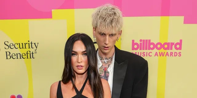 Megan Fox and Machine Gun Kelly poses backstage for the 2021 Billboard Music Awards, broadcast on May 23, 2021 at Microsoft Theater in Los Angeles.