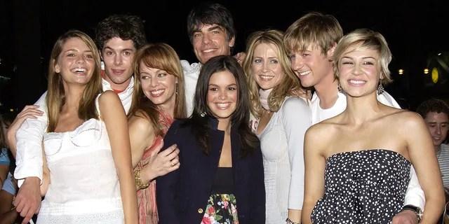 Cast of 'The O.C.' from left: Mischa Barton, Adam Brody, Melinda Clarke, Peter Gallagher, Kelly Rowan, Benjamin McKenzie, Samaire Armstrong and Rachel Bilson (center).