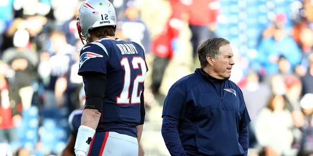 Tom Brady #12 of the New England Patriots and head coach Bill Belichick look on during warm ups before the AFC Championship Game against the Jacksonville Jaguars at Gillette Stadium on Jan. 21, 2018 in Foxborough, Massachusetts.