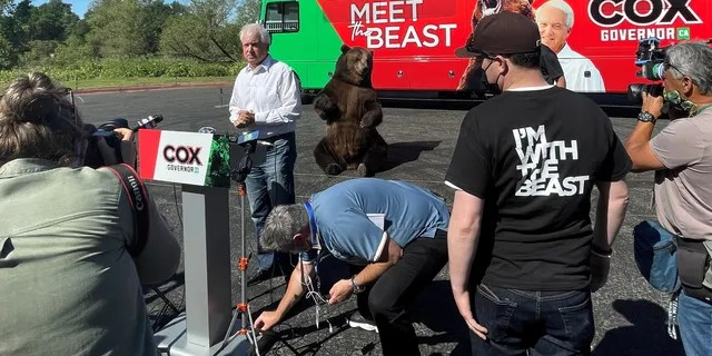 """Republican recall candidate John Cox teams up with 1,000 pound California grizzly bear as he kicks off """"Meet the Beast"""" bus tour, in Sacramento, California on May 4, 2021."""