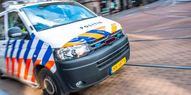 Dutch police car rushing to the scene of an incident in Amsterdam.