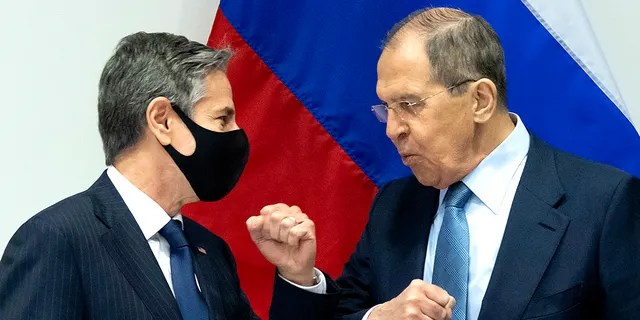 U.S. Secretary of State Antony Blinken, left, greets Russian Foreign Minister Sergey Lavrov, right, as they arrive for a meeting at the Harpa Concert Hall in Reykjavik, Iceland, Wednesday, May 19, 2021, on the sidelines of the Arctic Council Ministerial summit. (Associated Press)