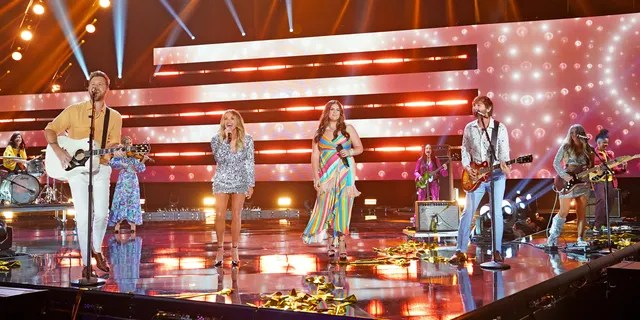 Lindsay Ell (far right) performs at the CMT Music Awards with Lady A while wearing a cast. (Photo by Erika Goldring/Getty Images for CMT)