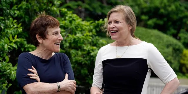 Liz Abzug, left, daughter of the late U.S. Rep. Bella Abzug, talks with Democratic candidate for mayor of New York Kathryn Garcia during a campaign event, in Bella Abzug Park, in New York, Tuesday, June 8, 2021. Abzug endorsed Garcia's candidacy. (AP Photo/Richard Drew)