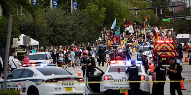 Police and firefighters respond after a truck struck a crowd injuring them during the Stonewall Pride Parade and Street Festival in Wilton Manors, Fla. On Saturday, June 19, 2021 (Associated Press)