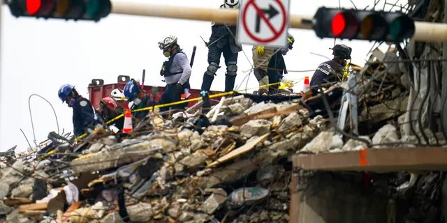 Crews work in the rubble of Champlain Towers South residential condo, Tuesday, June 29, 2021, in Surfside, Fla. Many people were still unaccounted for after Thursday's fatal collapse. (AP Photo/Gerald Herbert)