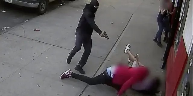 A suspect shoots a man in broad daylight in the Bronx, inches away from two terrified children. (NYPD)