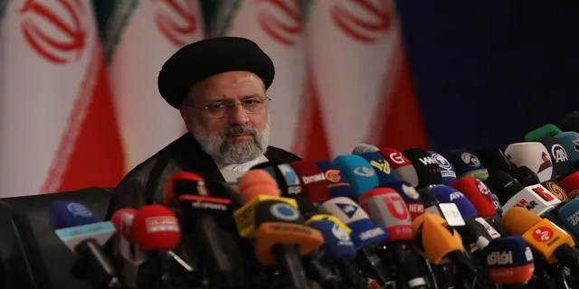 Iran's new President-elect Ebrahim Raisi speaks during a press conference in Tehran, Iran, on Monday. (AP)