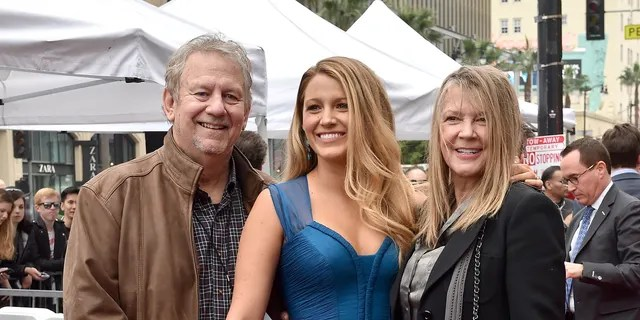 Actress Blake Lively, father Ernie Lively and mother Elaine Lively attend the ceremony honoring Ryan Reynolds with a Star on the Hollywood Walk of Fame on December 15, 2016, in Hollywood, Calif. (Photo by Axelle/Bauer-Griffin/FilmMagic)