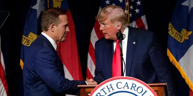 Former President Donald Trump, right, announces his endorsement of N.C. Rep. Ted Budd, left, for the 2022 North Carolina U.S. Senate seat as he speaks at the North Carolina Republican Convention Saturday, June 5, 2021, in Greenville, N.C. (AP Photo/Chris Seward)