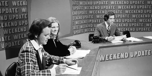 SATURDAY NIGHT LIVE -- Episode 11 -- Pictured: (l-r) Bill Murray, Jane Curtin, Chevy Chase during 'Weekend Update' on February 18, 1978.