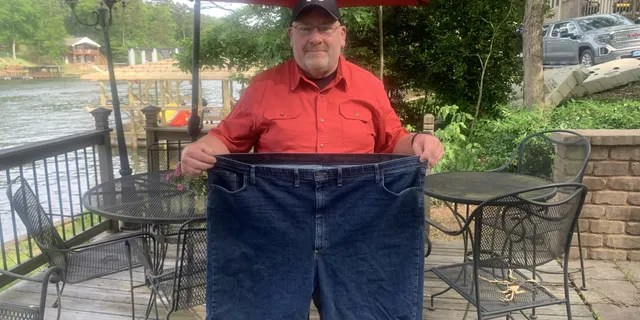 Before he started gaining weight, Moore (pictured) was a personal trainer. However, after becoming a single dad and after both his parents died, Moore spent years gaining weight, eventually reaching 443 pounds.