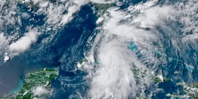 This GOES-16 GeoColor satellite image taken Monday, July 5, 2021, at 4:50 p.m. EDT, and provided by NOAA, shows Tropical Storm Elsa over western Cuba with strong rain and winds.