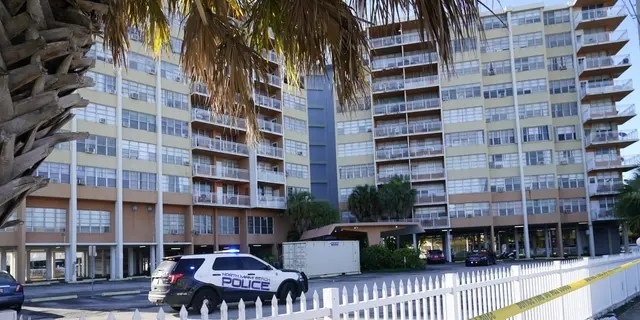 Police patrol outside Crestview Towers, which  was evacuated Friday after an audit following the deadly Champlain Towers collapse found the  building structurally and electrically unsafe Saturday, July 3, 2021, in North Miami Beach, Florida.  (AP Photo/Lynne Sladky )